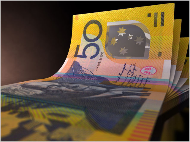 A group of five australian dollar banknotes fanned out and curved on an isolated white background
